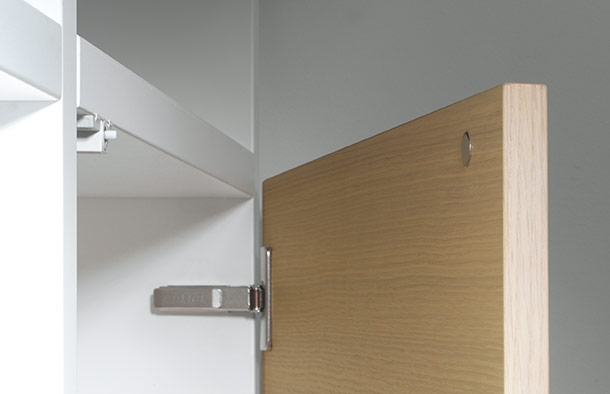 Push opening for handle-less doors